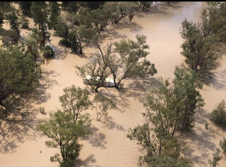 Man rescued after 14 hours stranded in flood waters