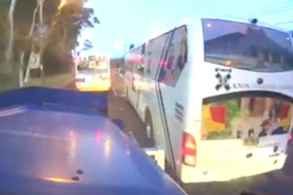 Article image for Knox Grammar school bus almost taking out a truckie in northern Sydney