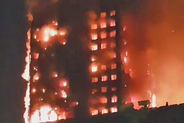 At least six dead after massive fire engulfs London tower block