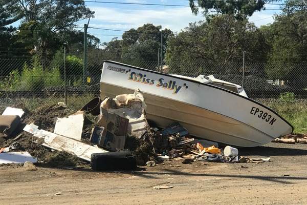 Article image for Boat dumped on the side of the road