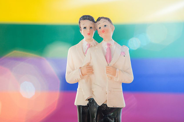 Straight men get hitched to avoid tax debt