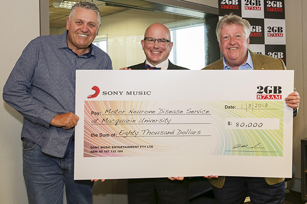 Ray presents massive cheque for a deserving cause