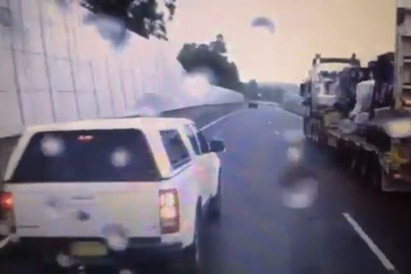 Article image for VIDEO | Idiotic driver plays chicken with a truck