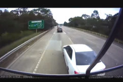 VIDEO   Truck's near miss with moronic driver