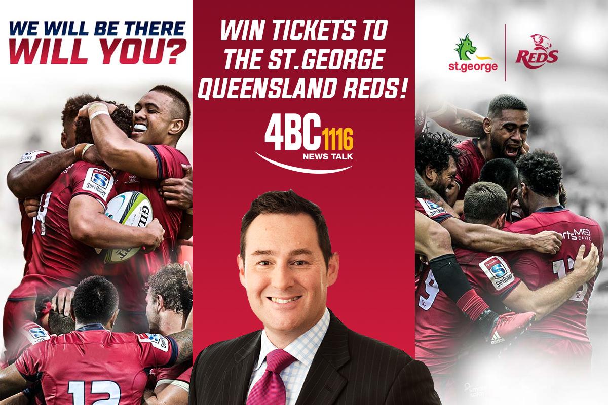 Quade Cooper jumps onto the Queensland Reds' celebrating pack