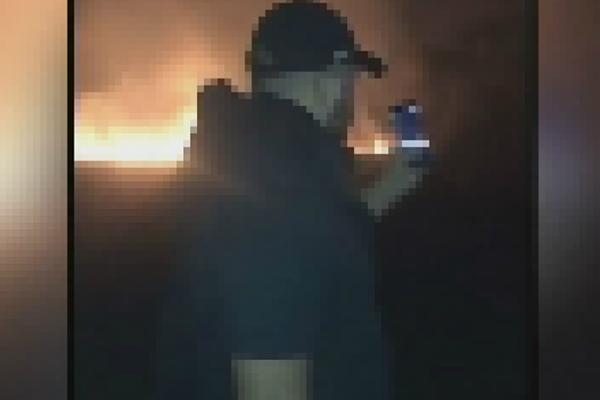 Disturbing footage shows men laughing as bushfires burn around them