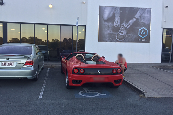 Ferrari parked in disabled parking spot at Sunshine Coast gym
