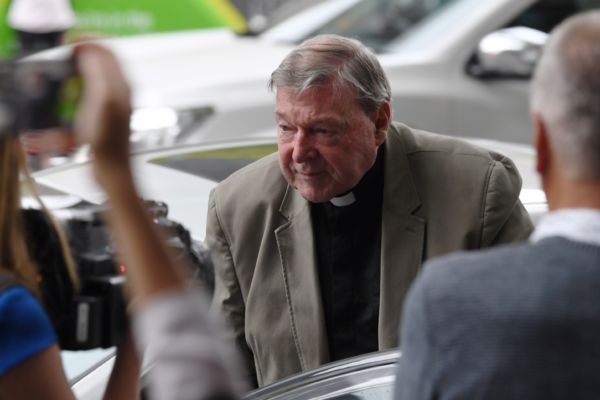 Cardinal George Pell committed to stand trial over historical sexual offences