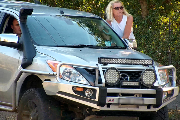 Article image for WATCH | Woman hanging off the side of moving 4WD