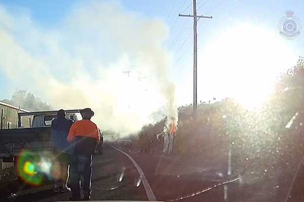 WATCH | Heroic QLD cops pull man from burning car