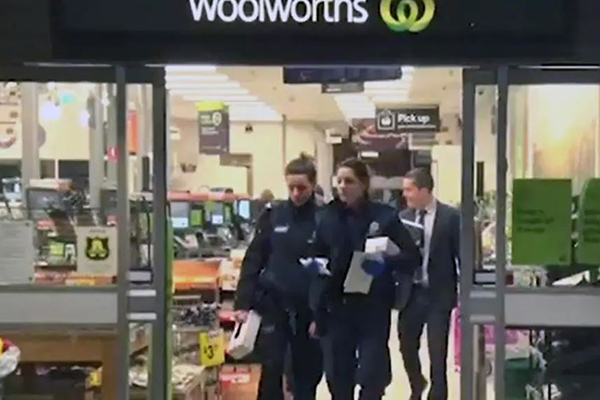 Article image for Boy stabbed by 'strangers' in Woolworths car park, couple on the run