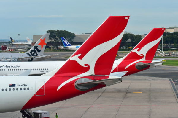 Qantas returns to paying company tax after posting record profit