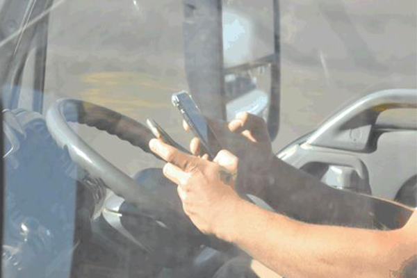 GALLERY | Drivers snapped using their phones behind the wheel