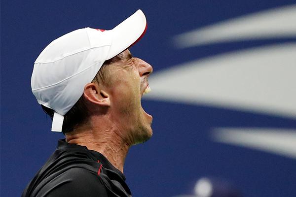 Article image for US Open upset: Australian John Millman defeats tennis great Roger Federer