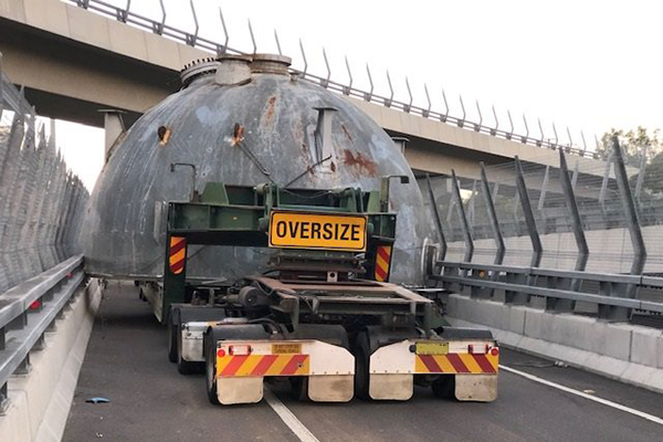 Oversized truck trapped for hours after becoming wedged on off-ramp