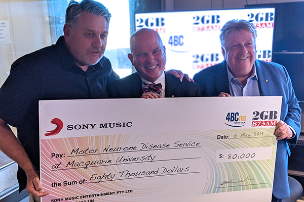 Ray Hadley presents another huge cheque for the fight against MND