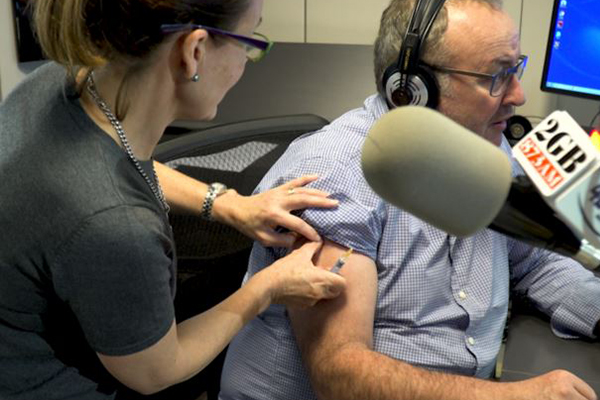 WATCH   Chris Smith gets flu shot live on-air