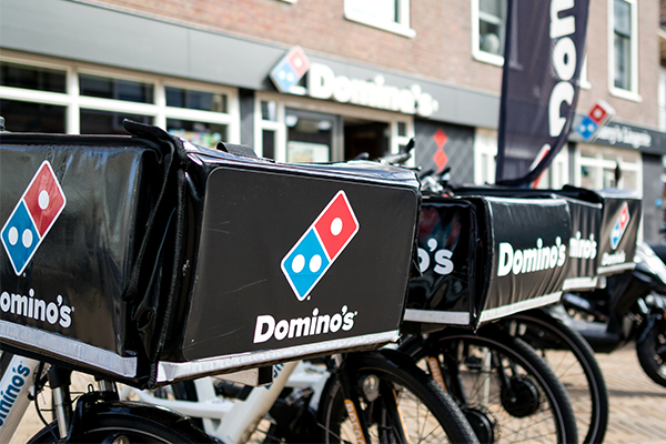 Domino's hit with class action over claims they underpaid workers