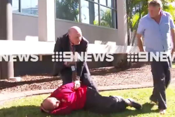 Article image for WATCH   Cop expertly tackles man who interrupted his press conference