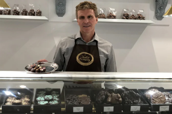 Paralympian breaks down on-air after having to shut his Brisbane chocolate shop