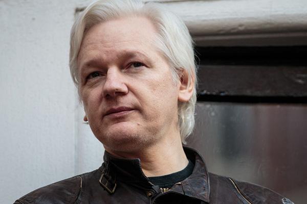 Article image for Australia slammed for 'piss-weak' treatment of Julian Assange