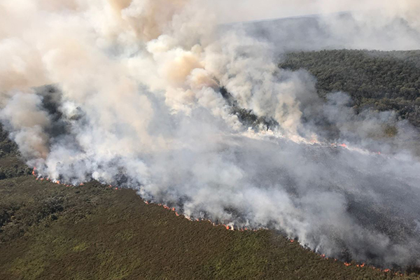 Brisbane swelters as fires rage across the state