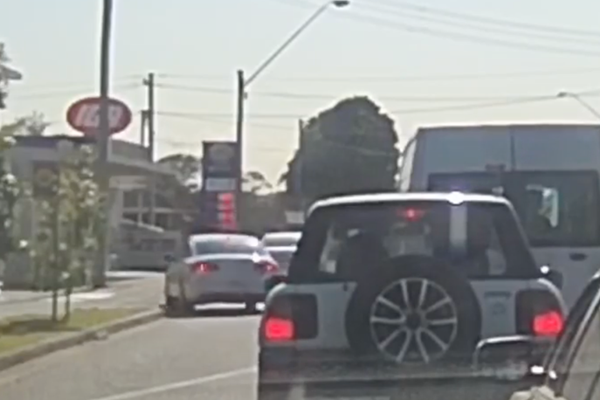 Article image for WATCH | Reckless driver mounts footpath in school zone