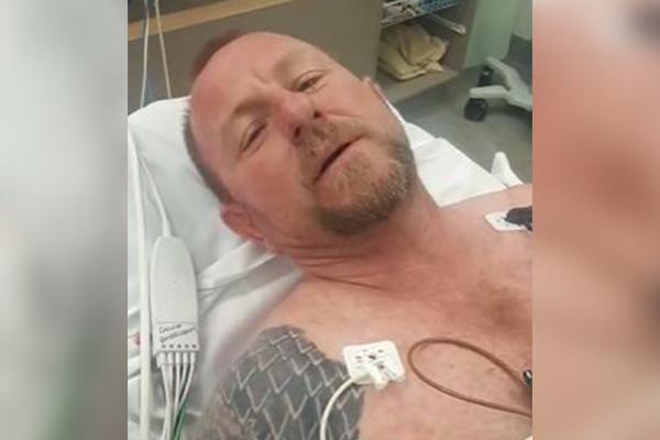 Article image for Queensland snake catcher hospitalised after bite from eastern brown snake