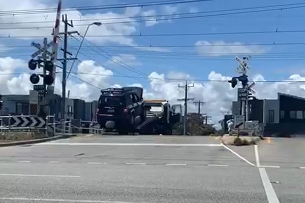 Article image for WATCH   Tow truck narrowly avoids being cleaned up by train