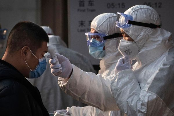 Article image for Fifth Australian infected with coronavirus, hundreds more trapped in China