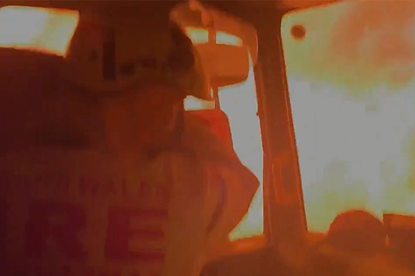 Article image for Firefighter describes moment his truck was overrun by flames