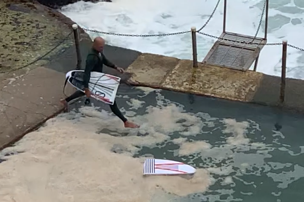 Article image for WATCH | Wipeout! Champion surfer Kelly Slater snaps his board