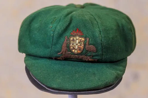 Article image for Sale of Don Bradman's baggy green stumps auctioneers