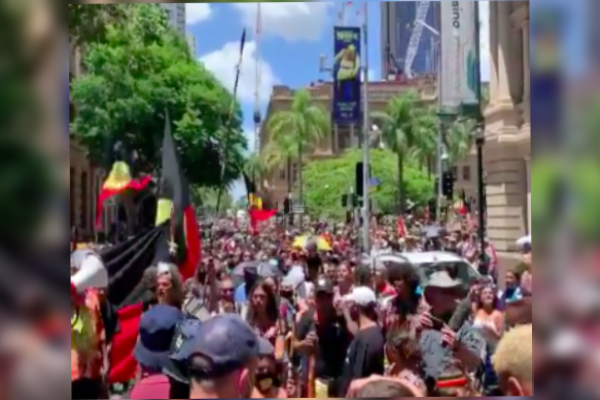 Article image for Thousands take part in Invasion Day rally through Brisbane's CBD