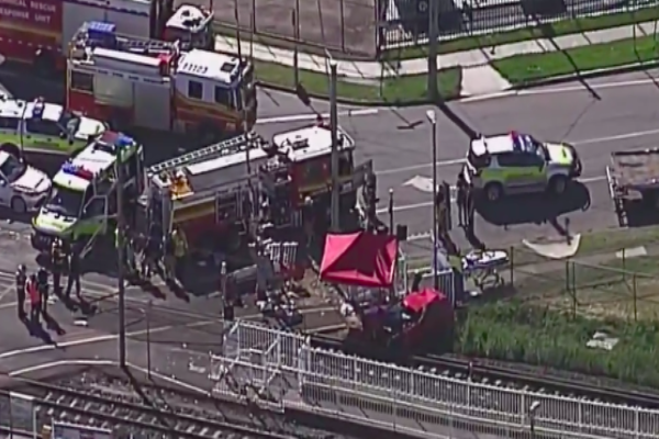 Woman dies after car and train collision in Brisbane