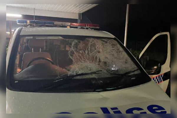 Police showered with glass as stray wheel shatters windscreen