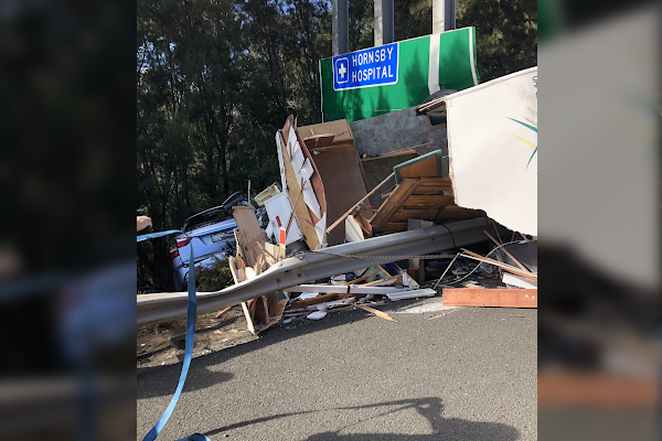 'Nasty' scene on M1 as car and caravan crash down embankment