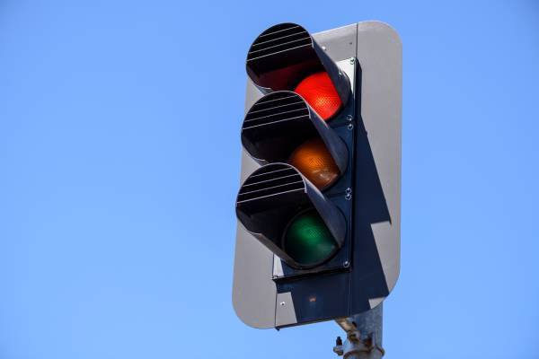Article image for Council and state government at loggerheads over 'left turn on red' signs