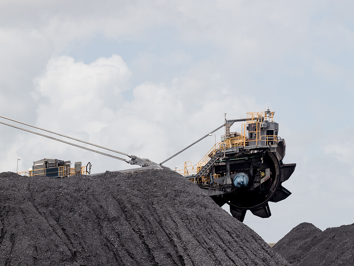 Adani boss gives pollies ultimatum as first coal stuck at controversial mine