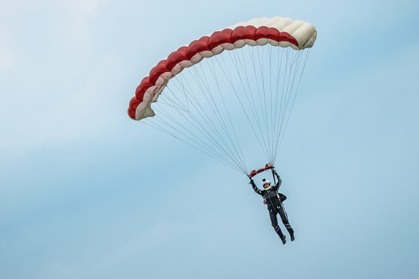 British solider crashes into suburban kitchen after parachute fails to open