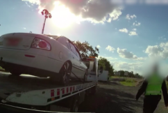 Police nab alleged border hopper in car being towed