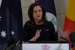 Queensland pauses interstate hotspot arrivals as hotels overflow