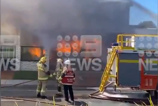 Article image for Firies race to control inferno taking hold of Carrara home