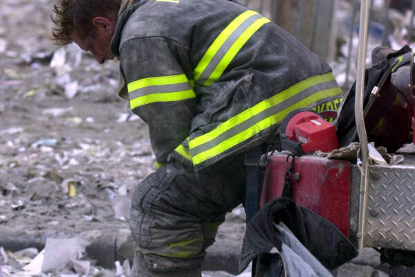 SEPTEMBER 11, 2001 : Overwhelmed firefighter sits amongst debris of World Trade Centre 11/09/01 following terrorist attack on New York. Pic Nathan Edwards. USA / Crime / Bombing / Terrorism / Fireman  Picture: Nathan Edwards