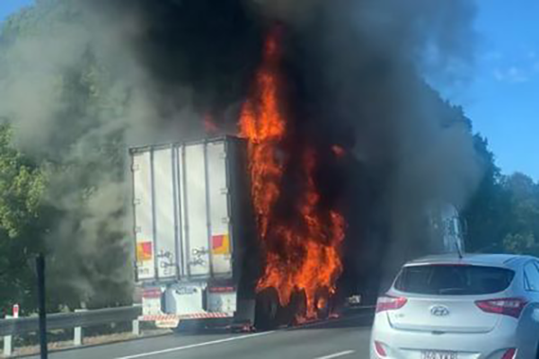 Article image for Traffic builds on M1 as truck engulfed in flames
